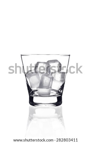 Glass with ice cubes on white background - stock photo