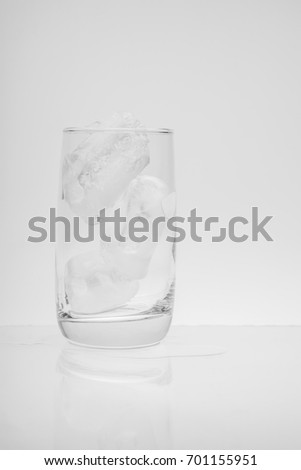 Glass with ice cubes. on white background