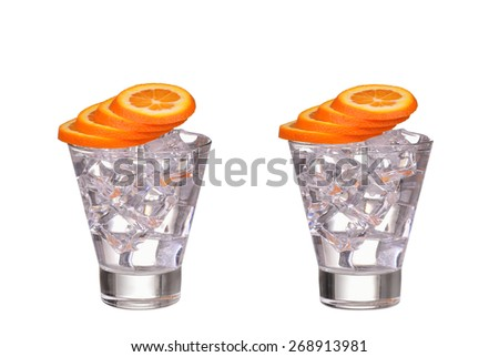 glass with ice cubes orange slice and water isolated on white background - stock photo