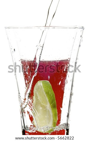 glass with juice and lime on the white background