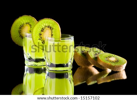 glass with kiwi and green liquor - stock photo