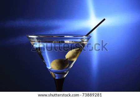 glass with martini and green olives - stock photo