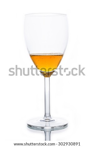 Glass with orange sparkling water separately isolated on white. - stock photo