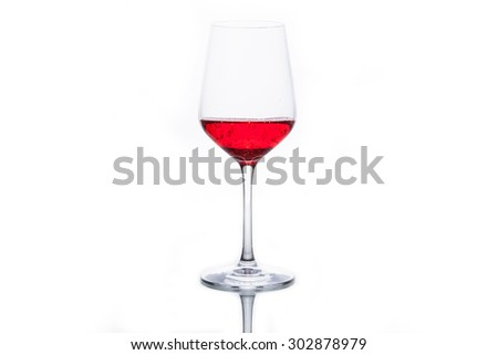 Glass with red sparkling water separately isolated on white.