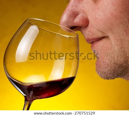 Glass with red wine smelling - stock photo