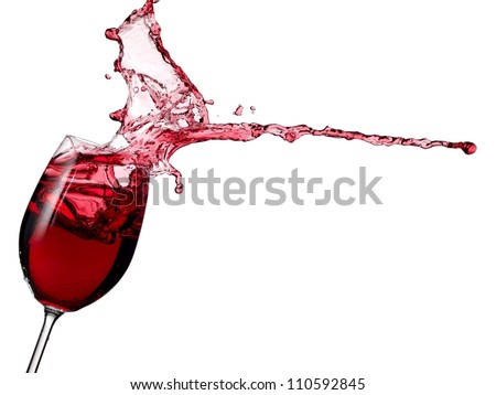 Glass with red wine splash - stock photo