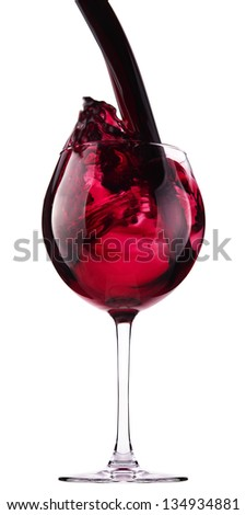 Glass with red wine splash