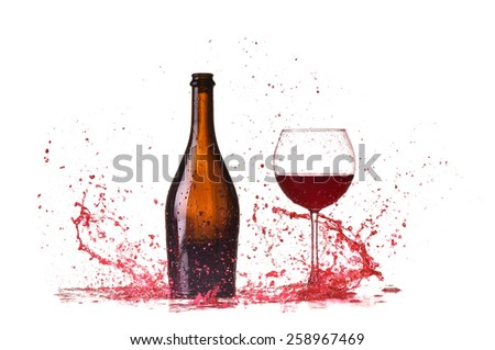 Glass with red wine splash bottle and glass with red wine, red wine splash, wine pouring on table isolated on white background, big splash around - stock photo