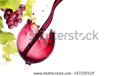 glass with red wine splash isolated on a white background