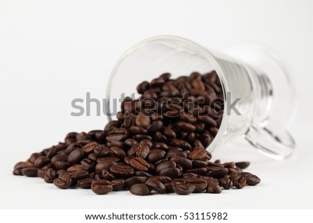 Glass with spilled coffee beans