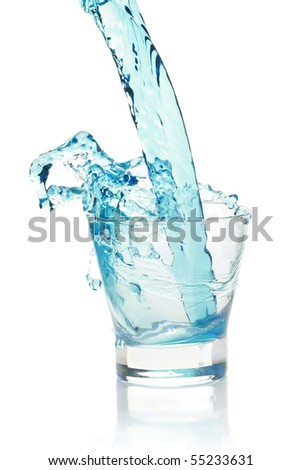 Glass with splashing blue drink. isolated on a white background
