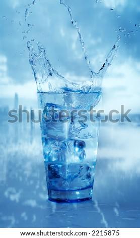 glass with splashing water - stock photo