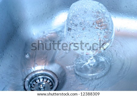 glass with water in sink