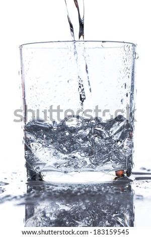 Glass with water on the table - stock photo