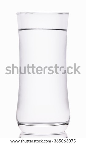 Glass with water on white background - stock photo