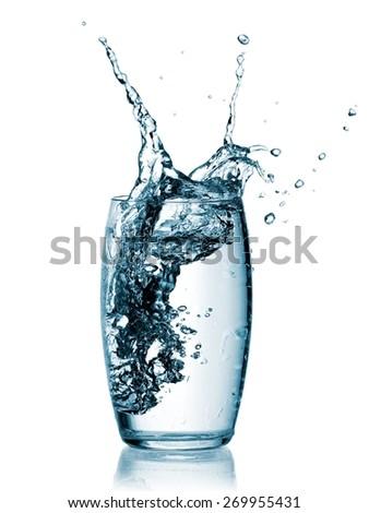 Glass with water splash - stock photo