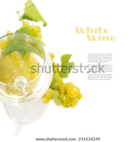 Glass with white wine and cluster of grapes isolated on white background with copyspace. Top view - stock photo