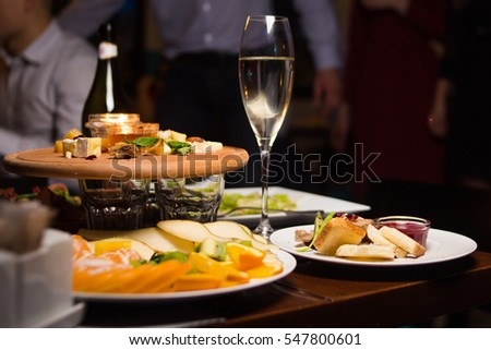 glass with wine,plate with food-catering service in restaurant