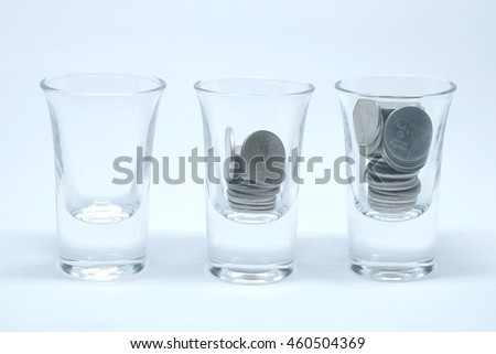 Glass without coins,glass with less coins and glass with many coins on clean background look like people made business work for more money in life. - stock photo