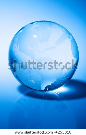 Glass world globe in blue tone - stock photo