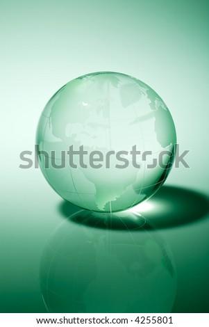 Glass world globe in green tone - stock photo