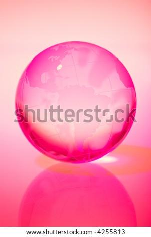 Glass world globe in pink tone - stock photo