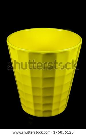 Glass yellow on black background - stock photo