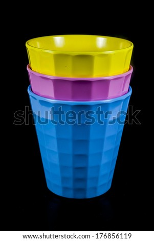 Glass yellow Pink blue. on black background - stock photo