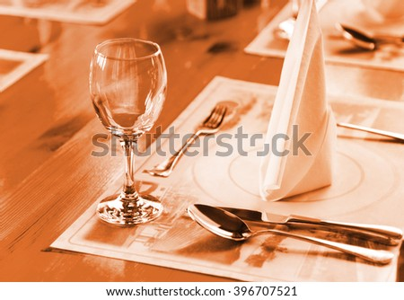 Glasse and plate on table in restaurant - food background - stock photo