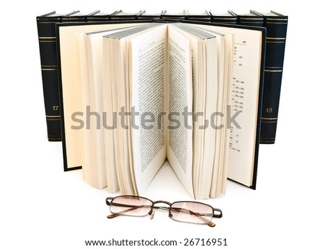 glasses against open book and books row at the white background - stock photo