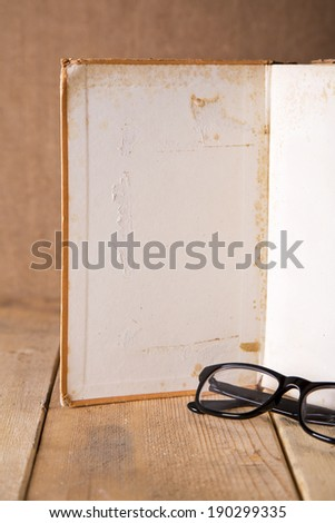 Glasses and an open book to write in - stock photo