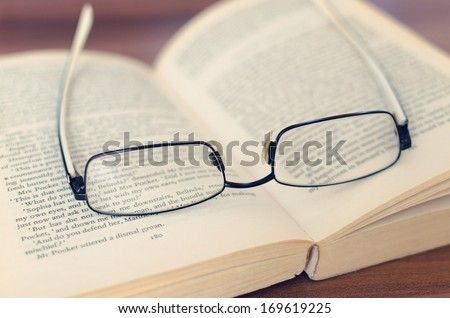 glasses and book - stock photo