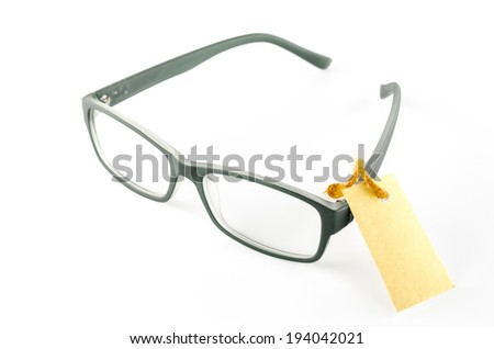 glasses and cost tag on a white background - stock photo