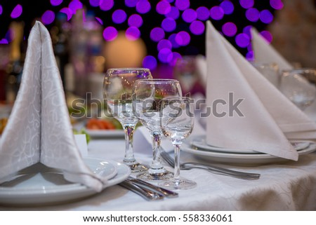 Glasses and dishes on the table