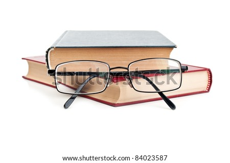 glasses and red book isolated on a white background - stock photo