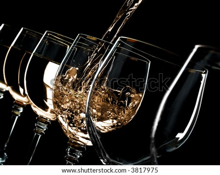 Glasses are filled up with alcohol one after another - stock photo