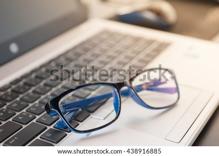 Glasses are placed on laptops,