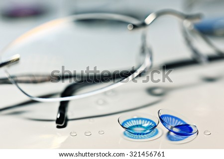 glasses, colored contact lenses, vision concept
