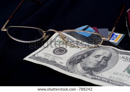 glasses, credit cards and money - stock photo
