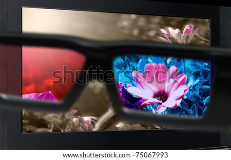 Glasses 3D in front of the TV with a flower. 3D television. - stock photo