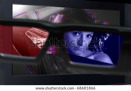 Glasses 3D in front of the TV with a woman. 3D television. - stock photo
