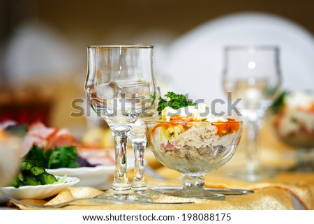 Glasses for drinks and cocktails at the festive table - stock photo