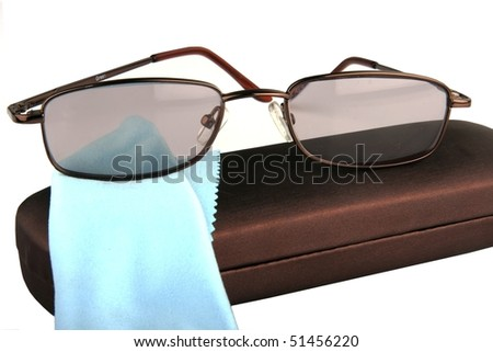Glasses for reading with cover and cleaning cloth isolated on white - stock photo