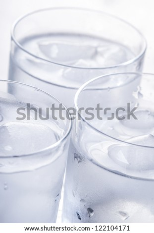 Glasses full of pure water with ice - stock photo