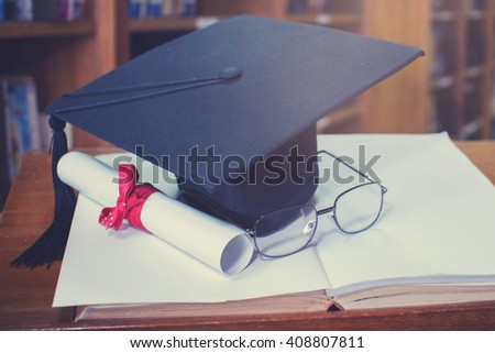 glasses graduation cap and Books step in Library room,Education concept  - stock photo