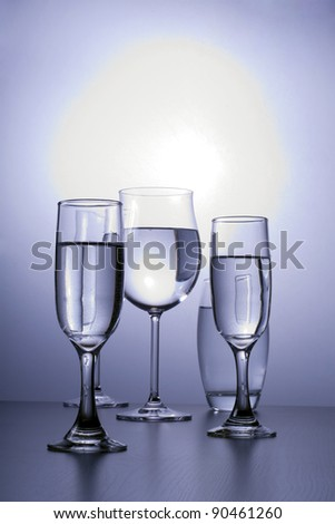 Glasses lit, minimalist style, side by side. - stock photo