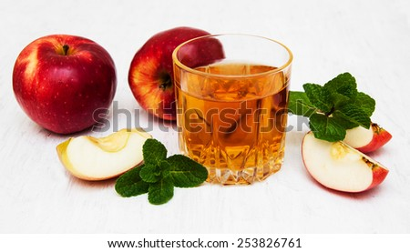 Glasses of apple juice and fresh red apple - stock photo