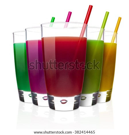Glasses of assorted fruit juices isolated on white