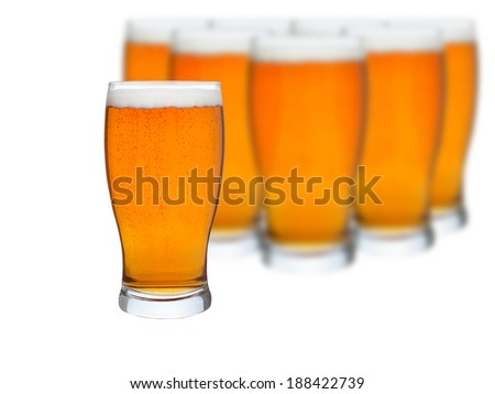 Glasses of beer isolated on a white background