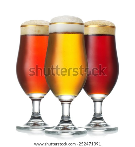 Glasses of beer isolated on a white background - stock photo